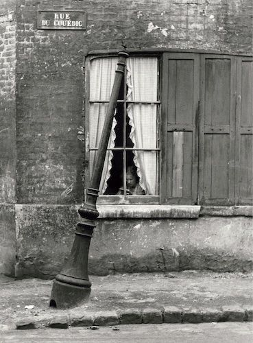 André Kertesz - Le Havre, France (woman in window), September 1948