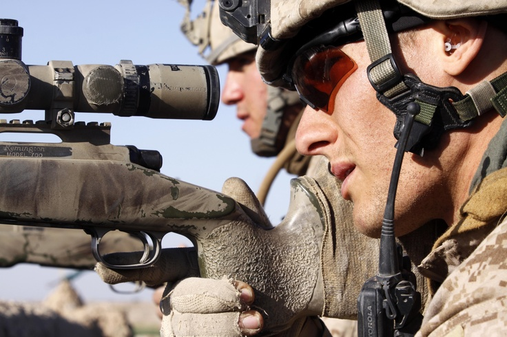 "HELMAND PROVINCE, Afghanistan – Lance Cpls. Keith B. Lawson and Spence G. Press, scout snipers attached to Charlie Company, 1st Battalion, 3rd Marine Regiment, work together to identify targets as Taliban fighters approached from Marjeh toward their position at the ""Five Points"" intersection Feb. 9. Lawson, 25, is from Reedly, Calif., and Press, 20, is from Newbury Park, Calif. photo by Sgt. Brian A. Tuthill)"