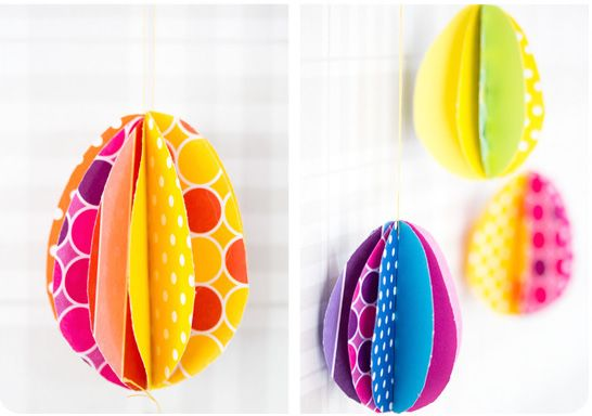 Easy Easter crafts: Colorful DIY Paper eggs to hang or use as table centerpieces.