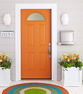 Burnt Orange Front Door With White Trim And Light Grey