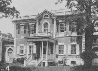 """In 1915, the Dumbarton House was moved 100 feet to its present site, to allow for the extension of Q Street into Georgetown.  From Streets of Washington: """"It took three weeks and 200 jacks to raise the old house a half-inch off the ground and probably several months after that to drag it into its new resting place, a spot that had been dug out of the hillside some 60 feet to the north. Regretfully, no pictures have been located that show how this complicated engineering feat was accomplished."""""""