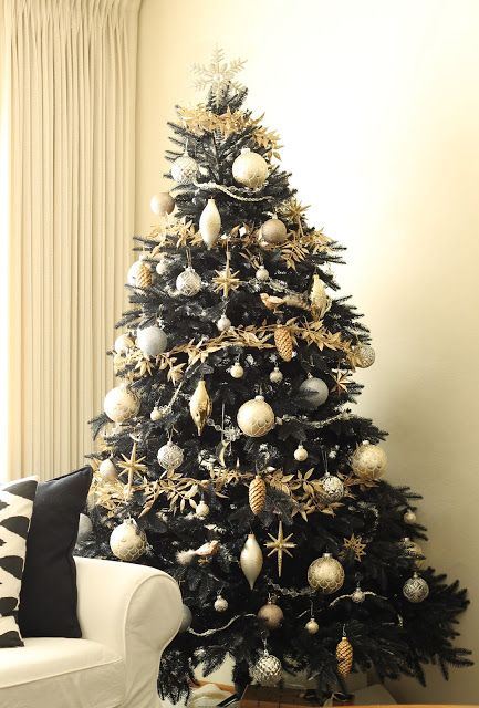Copy Cat Chic's black Christmas tree with metallic ornaments - so modern classy!