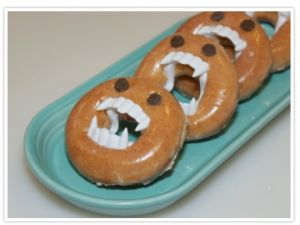 Halloween Doughnut idea using plastic vampire teeth