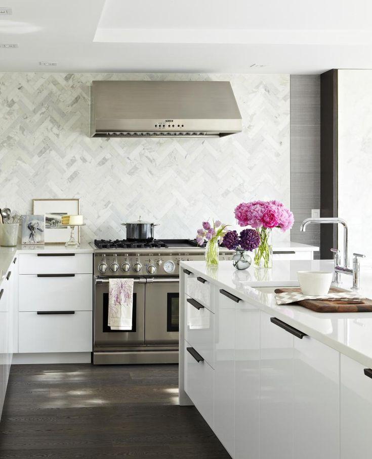 dark floors, backsplash, white kitchen