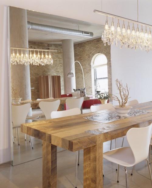 Modern chandelier over wood table home pinterest for Modern lighting over dining room table