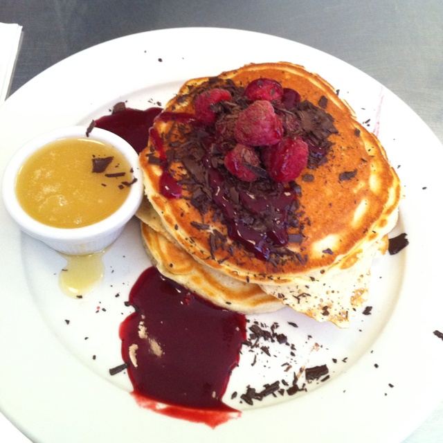 ... Pancake with chocolate chunks, fresh raspberries and raspberry-caramel