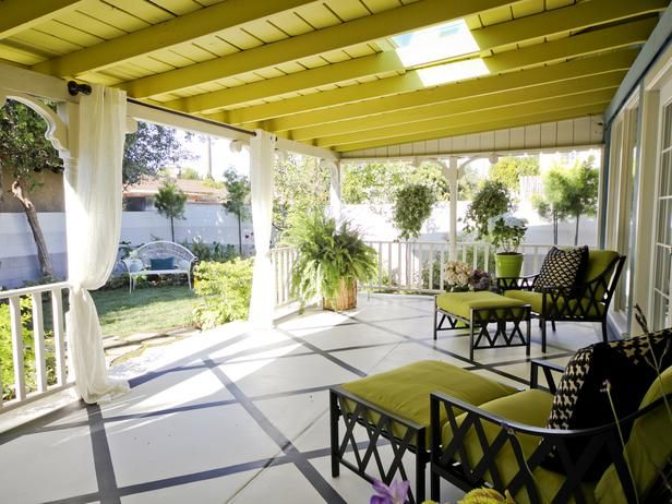 Skylights on the roof of this chartreuse porch let a little sunlight in while flowing curtains can close to filter light and create privacy. From HGTV's Going Yard.