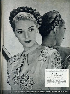 A thickly plaited wreath of hair. 1940s updo.
