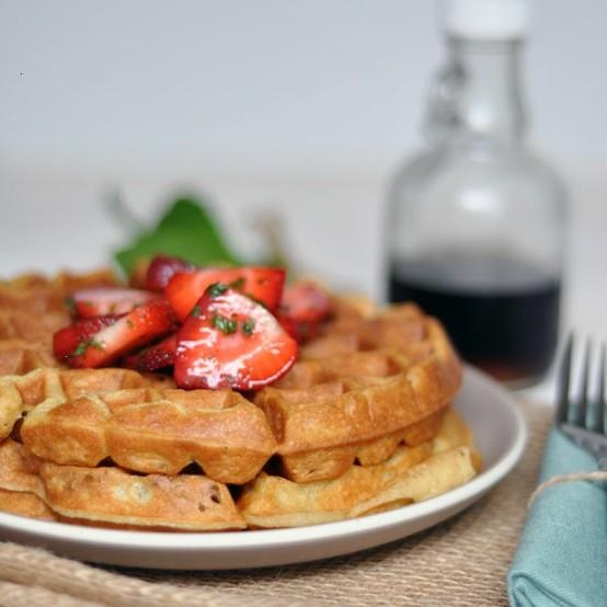 cardamom and nutmeg waffles with minted strawberries.