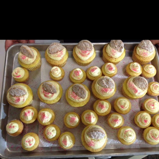 Lemon cupcakes with lemon frosting topped with Savannah Smiles :)