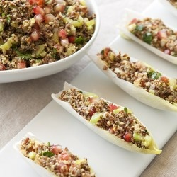 Quinoa boat Red quinoa mixed with diced squash and tomato served on ...
