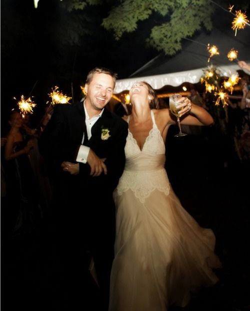 love the sparklers, her dress, and the fact there is a drink in her hand