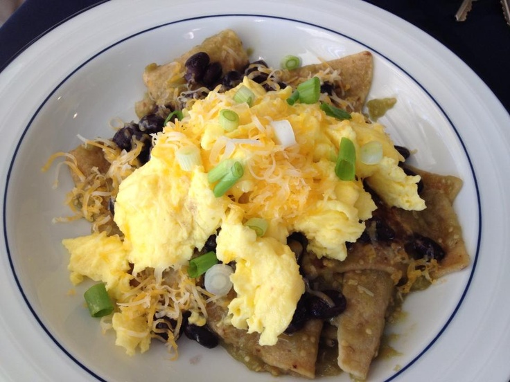 Homemade Chilaquiles! Tortilla chips cooked in salsa verde and topped ...