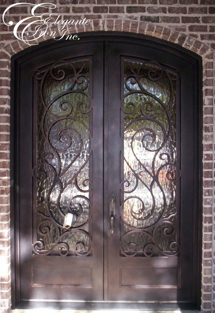 Custom wrought iron front door house projects pinterest for Wrought iron front doors
