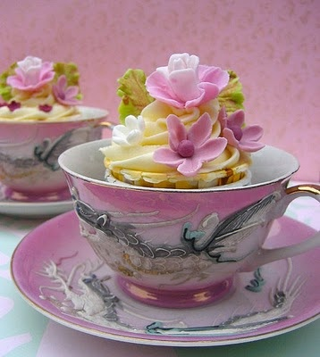 Cupcakes in teacups... the perfect dessert for an afternoon wedding.