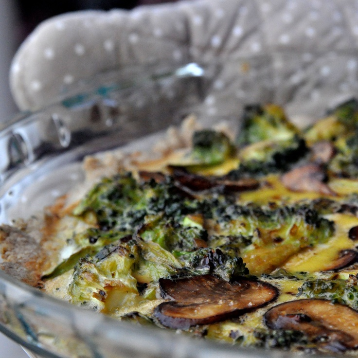 Paleo quiche crust topped with veggies
