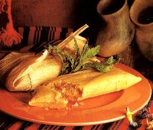 TamalesEASY STEPS TO MAKE TAMALES    RECIPE INGREDIENTS    6 cups Maseca corn masa mix for tamales  6 cups Chicken broth  1 cup corn oil  2 tsp salt  1 tsp baking powder  1 1/2 large rotisserie chicken  2 cans Salsa Verde or tomatillo sauce  1 bag corn husks    RECIPE INSTRUCTIONS    1. Soak the corn husks in warm water until soft.  2. Blend with an electric mixer Maseca corn masa mix for tamales, corn oil, salt, baking powder and the chicken broth to obtain a consistent mixture.  3. Shred the chicken and marinate in the green salsa or tomatillo sauce.  Spread masa evenly over corn husks, and spread a spoonful of marinated chicken on top of the masa.  4. Fold the sides of the cornhusk to center over the masa so that they overlap to make along package.  5. Fold the empty part of the husk under so that it rests against the side of the tamale with a seam.  6. Place the tamales in tamale steamer and cook tamales for 35-40 minutes. Check every 20 minutes. The tamales are cooked when they separate easily from the corn husk