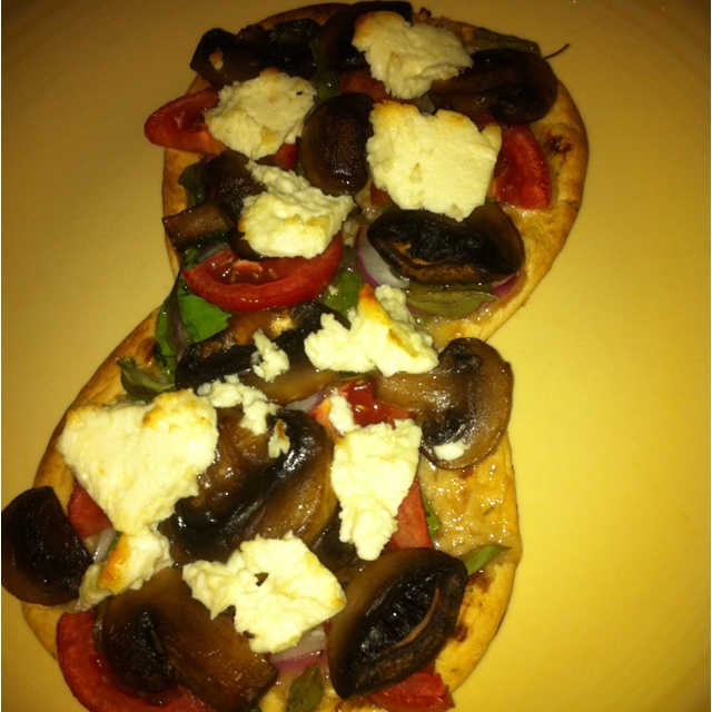 ... garlic, spinach, Roma tomato, red onion, mushrooms, basil, and feta