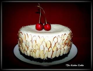 White Chocolate Almond Cheesecake with Black Cherry Sauce