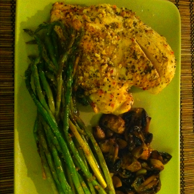 Lemon garlic herb chicken breast with sautéed mushrooms and asparagus