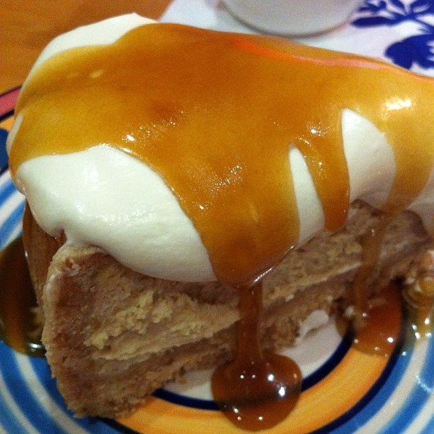 Vanilla baked cheesecake with salted caramel sauce and cream. thanks @ ...