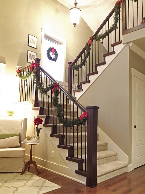 Staircase garland christmas pinterest for Hanging garland on staircase