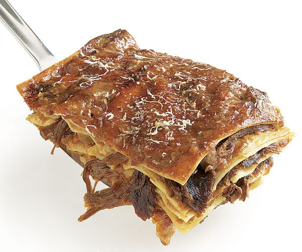 features beef short ribs that are slow-cooked in a hearty tomato sauce ...
