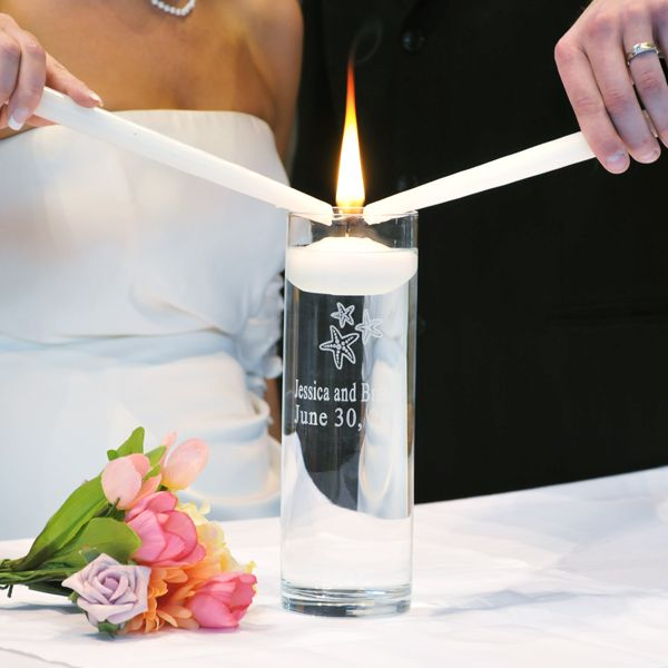 Bring the warmth of a jet set, island vacation to your hometown wedding with our Beach Wedding Floating Unity Candles. Engraved with two custom lines at no additional cost to you, this divine unity candle and vase set features a classic look and delicate, starfish design that will add appeal to every wedding ceremony celebration.