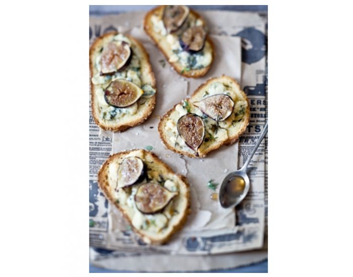 Figs and gorgonzola cheese on rustic toasted bread slices, drizzled ...