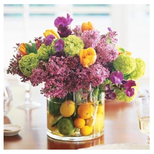 Purple an yellow flowers with green hydrangeas and citrus