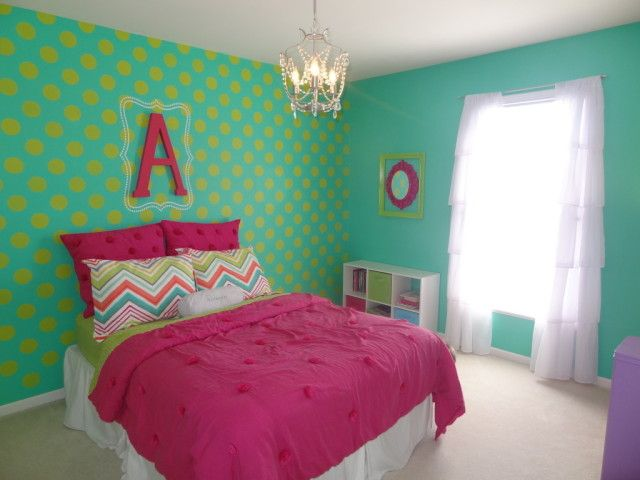 Colorful Big Girl Room with Polka Dot Accent Wall - We love the bright colors and mixture of patterns in this adorable #biggirlroom!