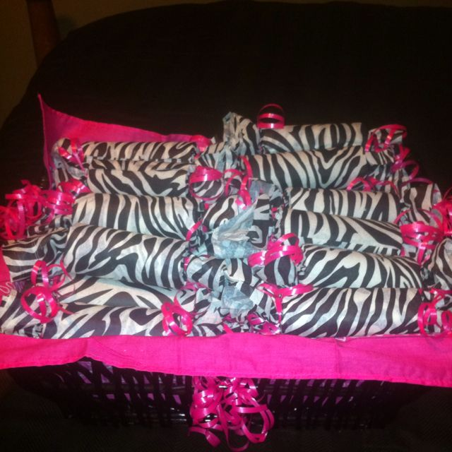Zebra print party favors with candy inside using toilet paper rolls.