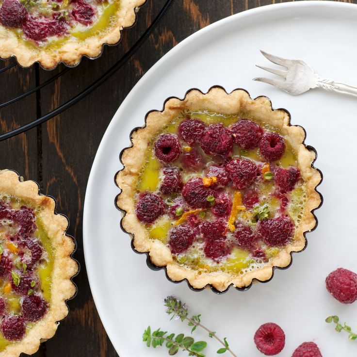 Raspberry Tart with lemon thyme in a pine nut crust. This is a ...
