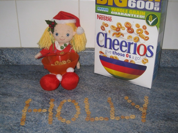 elf spelling out the kid's names with cereal