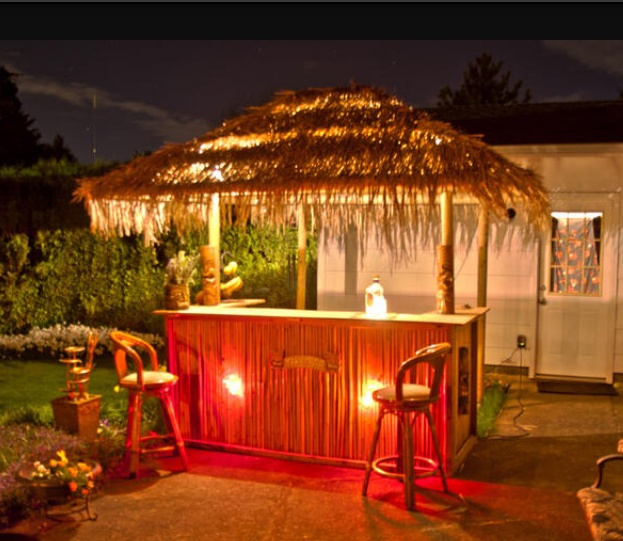 The tiki bar in her new home backyard decor pinterest for Tiki decorations home