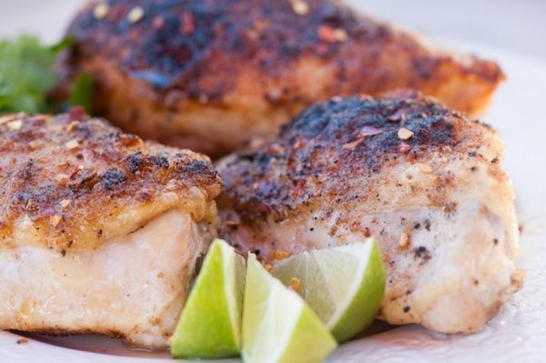 Chicken with cumin, coriander, garlic and sea salt topped with a mango ...