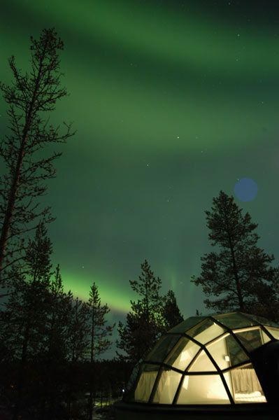 Hotel Kakslauttanen, located 250 km above the Arctic Circle in the Lapland region of Finland. Stay in a glass igloo designed to view the Northern Lights overhead.