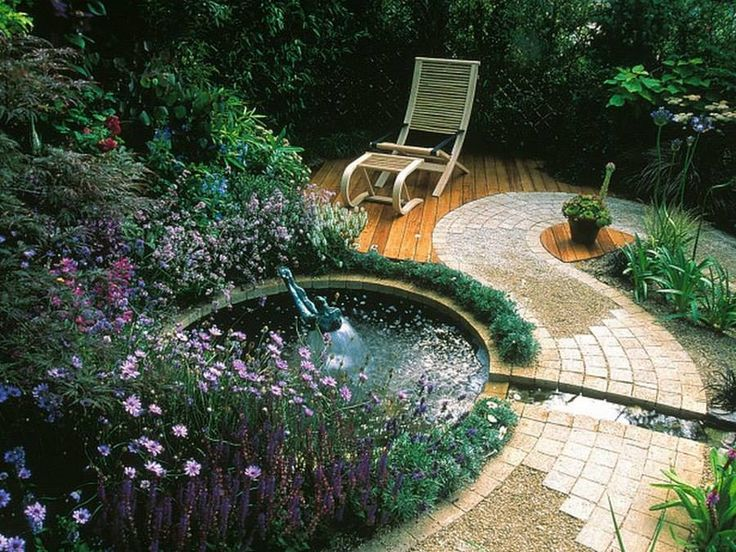 This backyard getaway has it all Calming water feature, pathway, deck