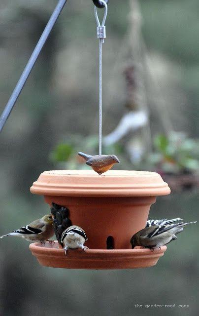 DIY Flowerpot bird feeder ~ site also has how to make wine bottle birdfeeders