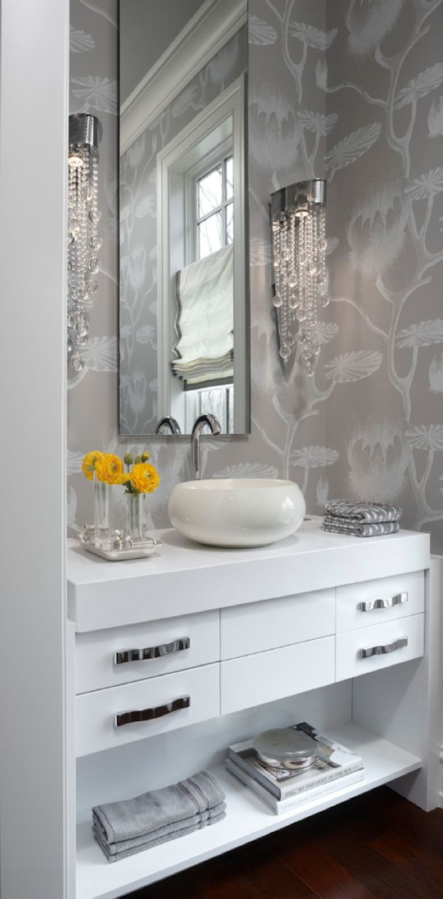 Powder Room - Wall paper with an Art Deco touch, porcelain vessel sink and a touch of glam with crystal wall sconces....bang on beautiful!