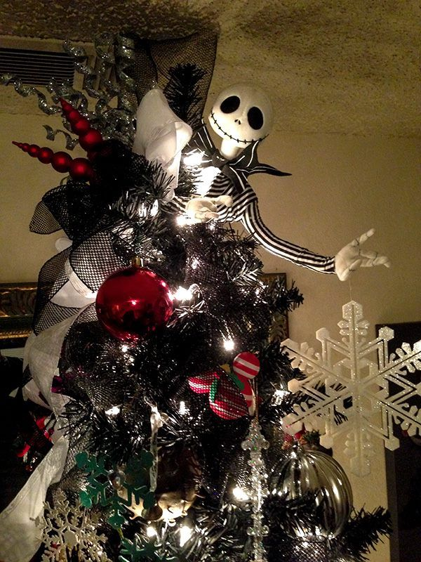 the cuteness of snowflakes and christmas baubles tamed the spookiness of jack skellington hanging around the christmas tree - Jack Skeleton Christmas Decorations