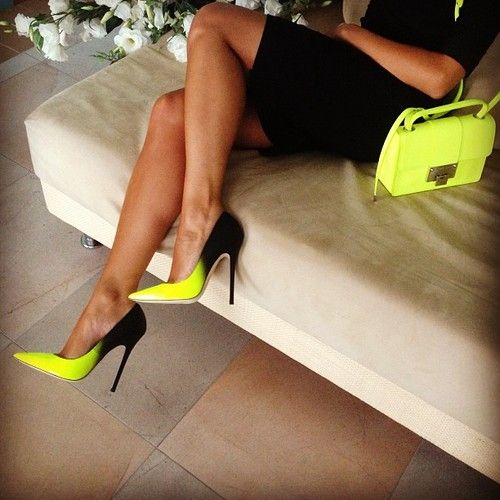 She looks awesome in this black and yellow.  This is a head turning outfit!