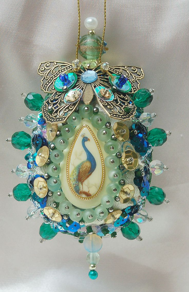 Blue, Green, Gold Peacock Egg Ornament: Vintage cameo, Has pale green silk backdrop. Trimmed with filigree butterfly, ornate braid, green glass beads,  sequins.