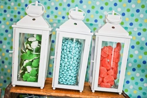 Decor idea: Place candy into glass vases and then display inside lanterns. {Click for more camping themed party ideas!} #kidsparty