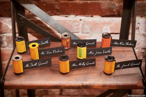 Film inspired escort cards on vintage ladder from Found Vintage Rentals.