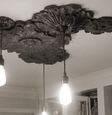 Tesselating Ceiling Roses - Maybe in a fun color with neat lights. Dining room? Kitchen over the island?