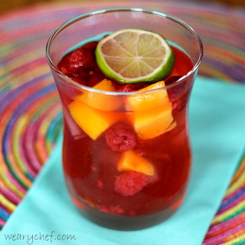 ... Pink Sangria with Raspberries and Mango #sangria #cocktail #raspberry