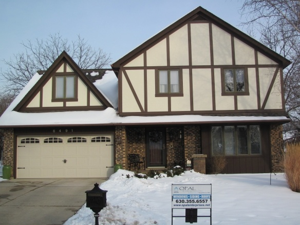 james hardie fiber cement stucco panels and trim on this tudor home