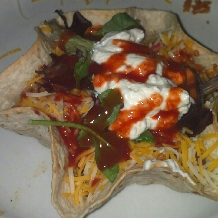 Taco bowl homemade Beans rice cheese sour cream choice of meat salad ...
