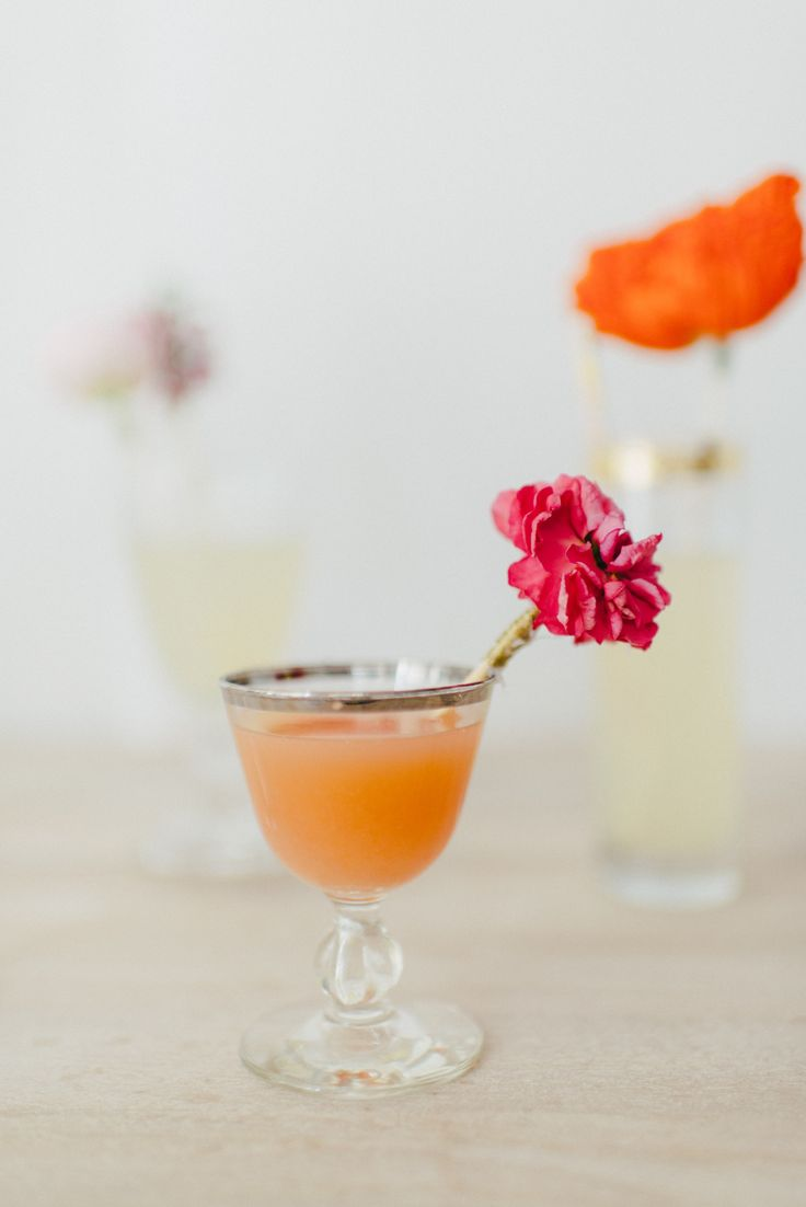 Beautiful flowers are attached to wood skewers for fabulous fresh flower drink stirrers! What a fun idea for the DIY bride!